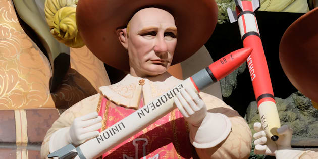 A figure representing Russian President Vladimir Putin is depicted at a monument during the Fallas festival, which will terminate with the burning of 391 monuments in the early morning hours of March 20, in Valencia, Spain March 16, 2018. REUTERS/Heino Kalis