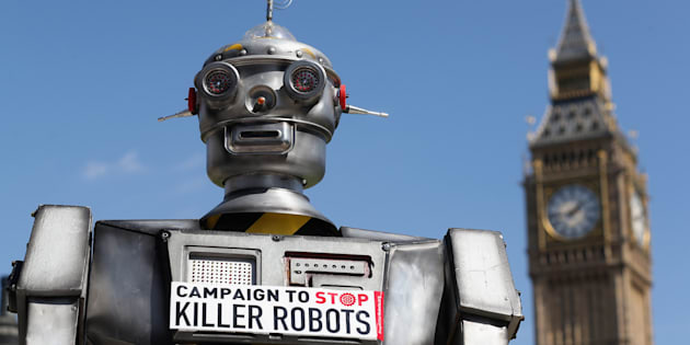 LONDON, ENGLAND - APRIL 23:  A robot distributes promotional literature calling for a ban on fully autonomous weapons.