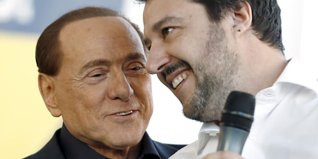 Forza Italia party (PDL) leader Silvio Berlusconi (L) talks with Northern League leader Matteo Salvini during a rally in Bologna, central Italy, November 8, 2015. The Northern League, Italy's third largest political force, is planning a major rally to voice its opposition to the government of Prime Minister Matteo Renzi.   REUTERS/Stefano Rellandini