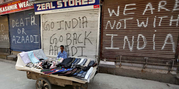 A vendor sits in front of closed shops during a strike called by Kashmiri separatists to protest the arrest of its members in Srinagar July 25, 2017. REUTERS/Danish Ismail