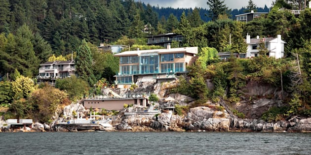 Luxury homes overlooking the water in West Vancouver, B.C. Sales of luxury properties declined sharply in three of Canada's biggest cities last year, realtor Sotheby's says.