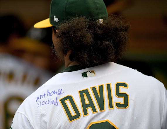 Khris Davis gets jersey signed by Make-A-Wish kid