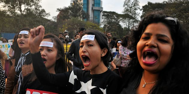 Women shout slogans as they take part in the #IWillGoOut rally, to show solidarity with the Women's March in Washington, along a street in Bengaluru, India, January 21, 2017. REUTERS/Abhishek N. Chinnappa
