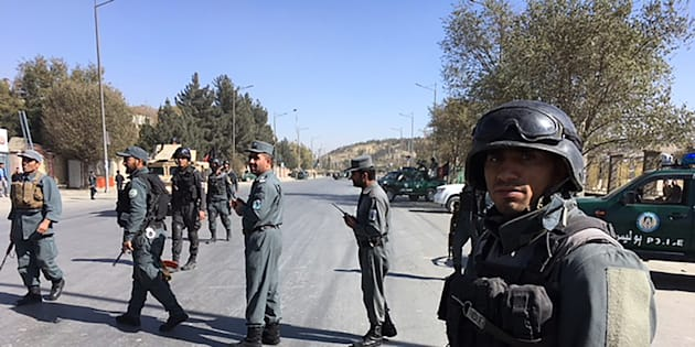 Afghan security personnel gather at the site of an ongoing attack on a television station in Kabul on November 7, 2017.