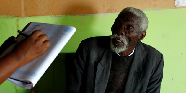 Former gold miner Senzele Silewise, 81, talks to paralegals in Bizana in South Africa's impoverished Eastern Cape province March 7, 2012. Silewise worked underground in the country's gold mines for 44 years before being diagnosed with silicosis.