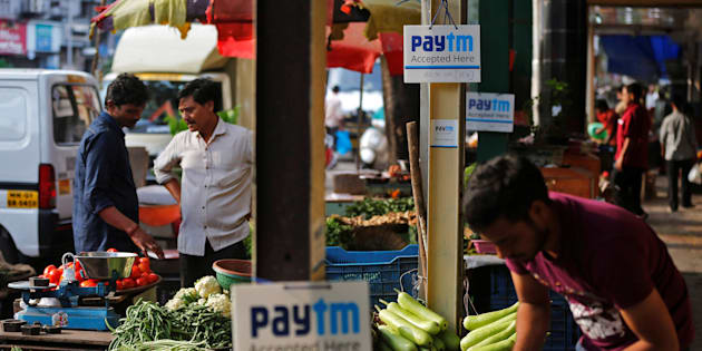 Advertisement boards of Paytm, a digital wallet company, are seen placed at stalls of roadside vegetable vendors as they wait for customers in Mumbai, India, November 19, 2016. Picture taken November 19, 2016. REUTERS/Shailesh Andrade
