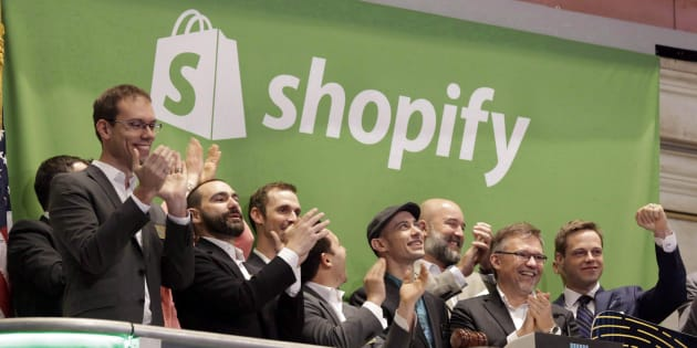 Shopify CEO Tobias Lutke, center wearing hat, rings the New York Stock Exchange opening bell, marking the Canadian company's IPO on May 21, 2015. Shopify is taking aim at weapons companies by banning the sale of some firearms and accessories on its platform.