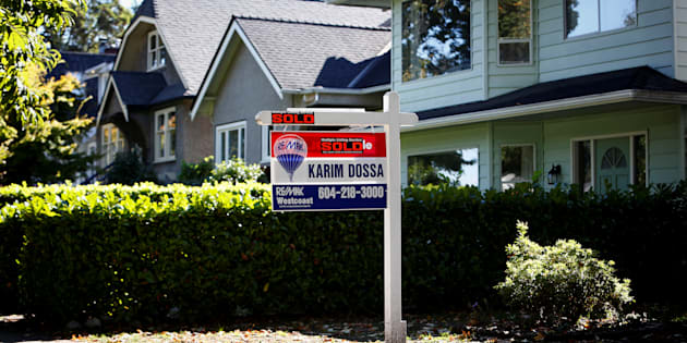 A for sale sign in front of a home in Vancouver, B.C., Sept. 22, 2016.