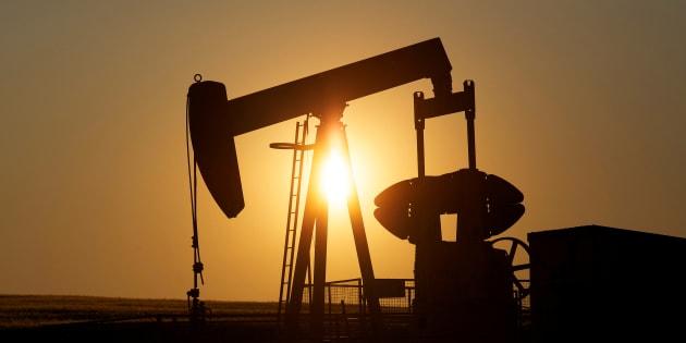 An oil pump jack pumps oil in a field near Calgary in 2014.