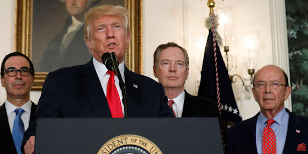 U.S. President Donald Trump, flanked by Treasury Secretary Steven Mnuchin (left), U.S. Trade Representative Robert Lighthizer (2nd right) and Commerce Secretary Wilbur Ross (right), at the White House in Washington, D.C., August 14, 2017. Neither Congress nor the Trump administration have studies the impact of a withdrawal from NAFTA.