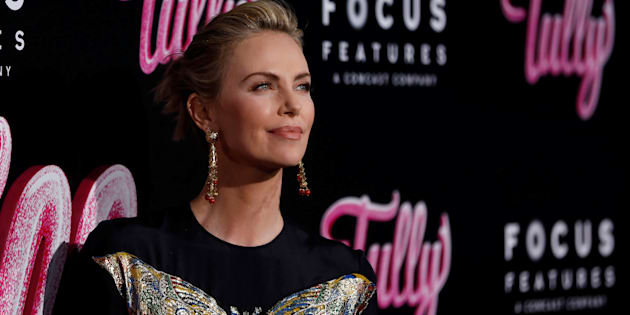 """Charlize Theron poses at the premiere for """"Tully"""" in Los Angeles April 18, 2018."""