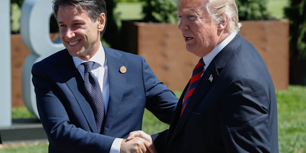 Italy's Prime Minister Giuseppe Conte shakes hands with U.S. President Donald Trump after a family photo at the G7 Summit in the Charlevoix city of La Malbaie, Quebec, Canada, June 8, 2018. REUTERS/Yves Herman