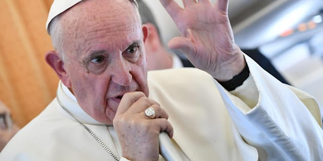 Pope Francis speaks to journalists on his flight back to Rome, Italy Nov. 1.