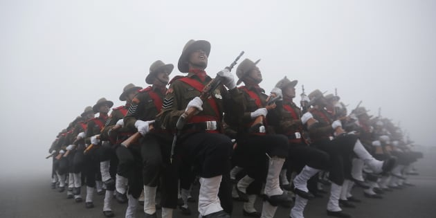 Indian soldiers take part in the rehearsal for the Republic Day parade on a foggy winter morning in New Delhi.