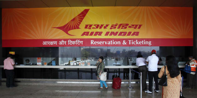 """Customers stand at an Air India reservation office at the domestic airport in Mumbai May 8, 2012. Air India has cancelled four international flights after about a 100 pilots called in """"sick"""" late on Monday, in a move to mount pressure on the state-run carrier on their demands for exclusivity in flying Boeing's Dreamliner. REUTERS/Vivek Prakash (INDIA - Tags: BUSINESS TRANSPORT)"""