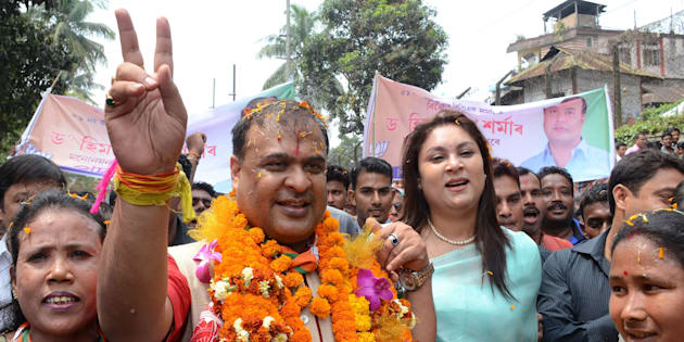 Indian candidate Himanta Biswa Sarma (2nd L) of the BJP is accompanied by supporters on the way to file nomination papers from Jalukbari Assembly Constituency in Guwahati on March 21 2016.