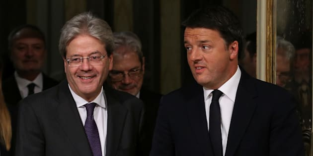 Newly appointed Italian Prime Minister Paolo Gentiloni (L) and his predecessor Matteo Renzi arrive to attend the bell ceremony, to signify the start of Gentiloni's first cabinet meeting, at Chigi Palace in Rome, Italy December 12, 2016. REUTERS/Alessandro Bianchi