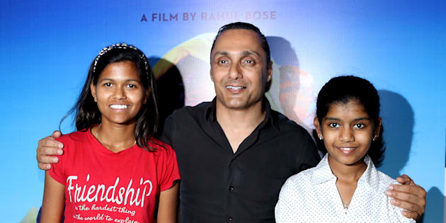 Indian mountaineer Poorna Malavath (L) and actress Aditi Inamdar (R) attend the screening of upcoming Hindi film 'Poorna' directed by Rahul Bose (C).
