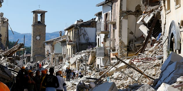 A collapsed house is seen following an earthquake in Amatrice, central Italy, August 24, 2016. REUTERS/Stefano Rellandini