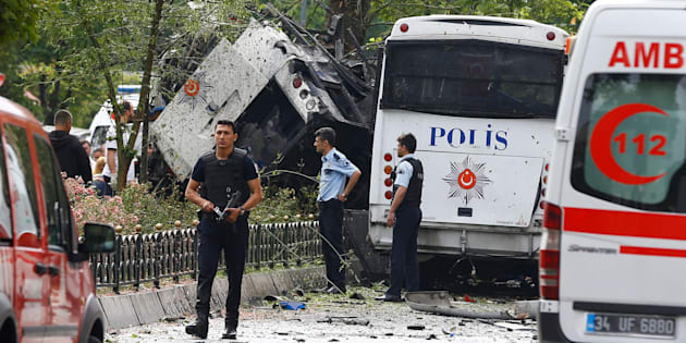 Police walk near a Turkish police bus which was targeted in a bomb attack in a central Istanbul district, Turkey, June 7, 2016.    REUTERS/Osman Orsal