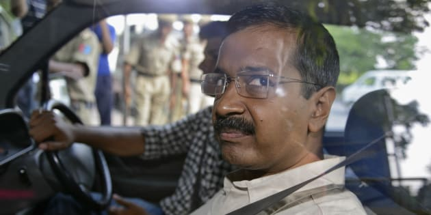 Arvind Kejriwal, the head of the Aam Aadmi Party (AAP), which briefly controlled the state government in Delhi, looks out from inside his car as he arrives at a court in New Delhi May 21, 2014.