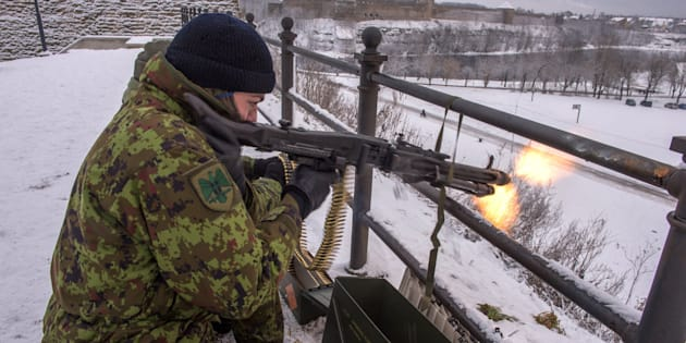An Estonian paramilitary volunteer fires a machine gun yards from the border with Russia.Jan. 14.