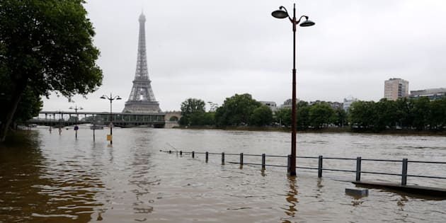 View of the flooded Seine near the Eiffel Tower in Paris on June 3, 2016, after days of almost nonstop rain.