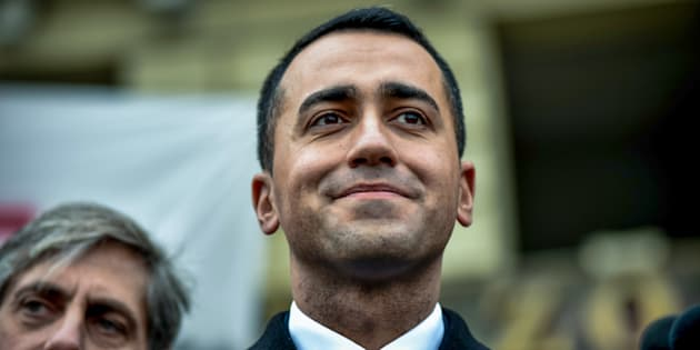 Luigi Di Maio, leader of the anti-establishment Five Star Movement (M5S), attends a flash mob, during which the movement's councilors from the Piedmont region delivered 102.948,77 euros to allocate part of their emoluments to citizens from the AIB, a group of volunteers fighting forest fires, on January 12, 2018 in Turin. / AFP PHOTO / Piero CRUCIATTI        (Photo credit should read PIERO CRUCIATTI/AFP/Getty Images)
