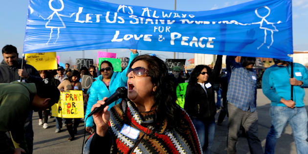 Hira Nair leads a chant during a march before a vigil for Srinivas Kuchibhotla, an Indian engineer who was shot and killed, at a conference center in Olathe, Kansas, U.S., February 26, 2017.   REUTERS/Dave Kaup