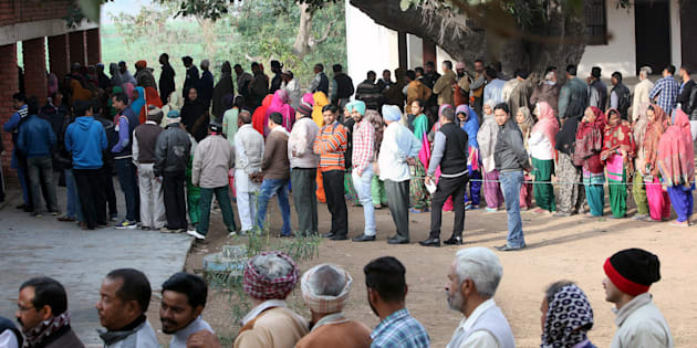 Voters line up to cast their votes outside a polling station during the state assembly election in the northern state of Punjab, in the village of Nada, India, February 4, 2017.
