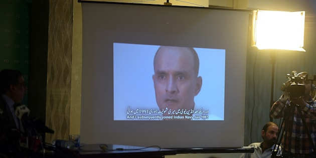 March 29, 2016: Pakistani journalists watch a video showing Indian national Kulbhushan Yadav, arrested on suspicion of spying, during a press conference in Islamabad.