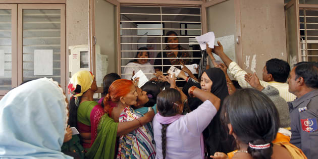 FILE PHOTO: Woman jostle to enrol themselves for Unique Identification (UID) database system in Ahmedabad February 14, 2013.