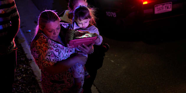 A woman who was shopping with her child during a shooting at a Walmart leaves the area in Thornton, Colorado November 1, 2017.  REUTERS/Rick Wilking