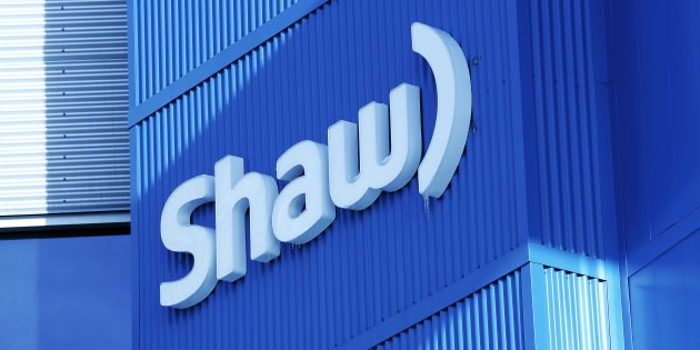 The Shaw logo is pictured on their Barlow Trail building, home to the annual Shaw AGM, in Calgary, Jan. 14, 2014. Shaw says the company will manage the timing of the departures in an orderly fashion over 18 months to minimize the impact on the business.