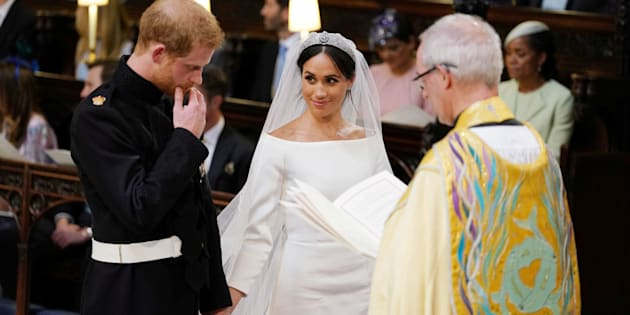 Prince Harry and Meghan Markle in St George's Chapel at Windsor Castle during their wedding service, conducted by the Archbishop of Canterbury Justin Welby in Windsor, Britain, May 19, 2018. Dominic Lipinski/Pool via REUTERS