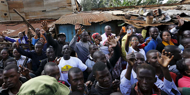 The faithful wave during Pope Francis' visit to the Kangemi slums on the outskirts of Kenya's capital Nairobi in November 2015. Developers are starting to build affordable homes in Kenya, regarded as critical to stop the spread of such slums.