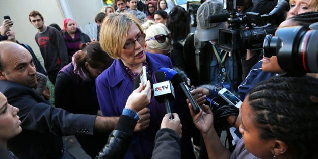 Helen Zille (C) speaks to the media before casting her vote in Rondebosch, Cape Town, May 7, 2014.