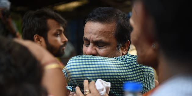 An Indian relative of a victim of a stampede on a railway bridge reacts outside a mortuary where bodies were being brought in Mumbai on September 29, 2017.