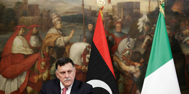 Libyan Prime Minister Fayez al-Sarraj attends a news conference with his Italian counterpart Paolo Gentiloni (not seen) at Chigi Palace in Rome, Italy, July 26, 2017.  REUTERS/Max Rossi