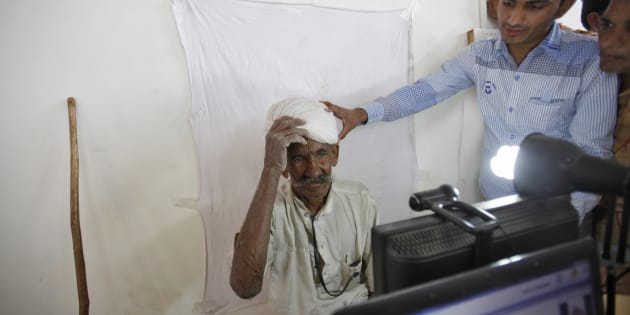 REPRESENTATIVE IMAGE: A villager gets ready to be photographed for the Unique Identification (UID) database system at an enrolment centre at Merta district in Rajasthan.