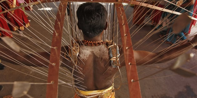 [File photo] A Hindu devotee, whose body is pierced with skewers, takes part in the religious festival of Panguni Uthiram in Chennai on 26 March 2013.