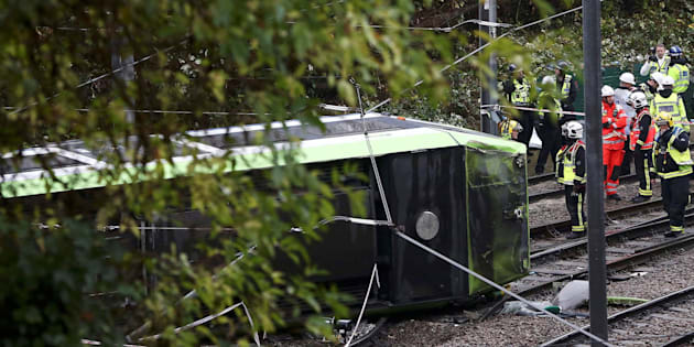 Members of the emergency services work next to a tram after it overturned injuring and trapping some passengers in Croydon, south London, Britain November 9, 2016.