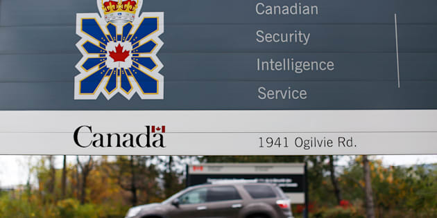 A vehicle passes a sign outside the Canadian Security Intelligence Service (CSIS) headquarters in Ottawa on Nov. 5, 2014.