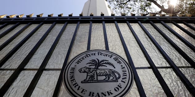 FILE PHOTO: The Reserve Bank of India (RBI) seal is pictured on a gate outside the RBI headquarters in Mumbai.