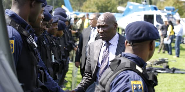 South African police chief Bheki Cele shakes hands with members of police during their presentation of readiness for the 2010 FIFA Soccer World Cup in Johannesburg, April 16, 2010.
