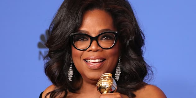 Oprah Winfrey poses backstage with her Cecil B. DeMille Award.