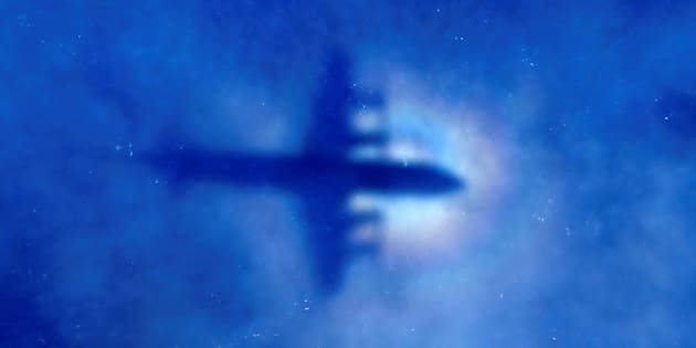 FILE PHOTO: The shadow of a Royal New Zealand Air Force (RNZAF) P3 Orion maritime search aircraft can be seen on low-level clouds as it flies over the southern Indian Ocean looking for missing Malaysian Airlines flight MH370 March 31, 2014.  REUTERS/Rob Griffith/Pool/File photo     TPX IMAGES OF THE DAY