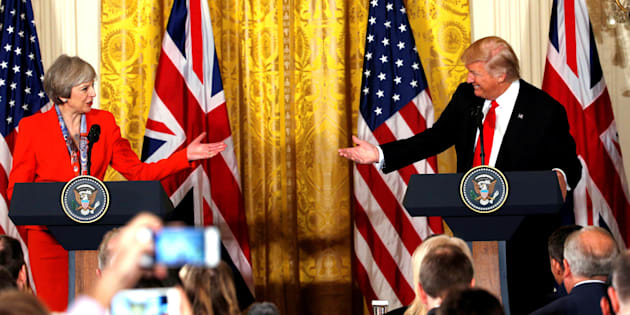 British Prime Minister Theresa May and U.S. President Donald Trump gesture towards each other during their joint news conference at the White House in Washington, U.S., January 27, 2017.   REUTERS/Kevin Lamarque