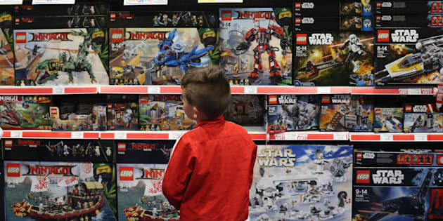 A young boy looks at Lego set for sale at the BRICKLIVE event for Lego fans at the Titanic Exhibition Centre in Belfast.