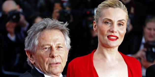 Roman Polanski et sa femme Emmanuelle Seigner posent sur le tapis rouge lors de la 66e cérémonie du Festival de Cannes le 25 mai 2013.